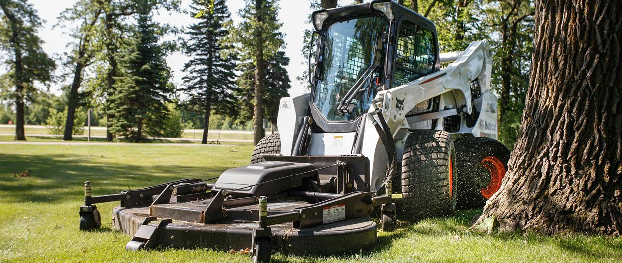 Bobcat A770 all-wheel steer loader with mower attachment.
