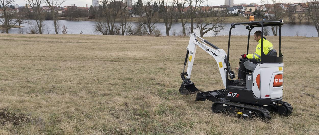 Bobcat E17z compact excavator (mini excavator) with auger attachment.
