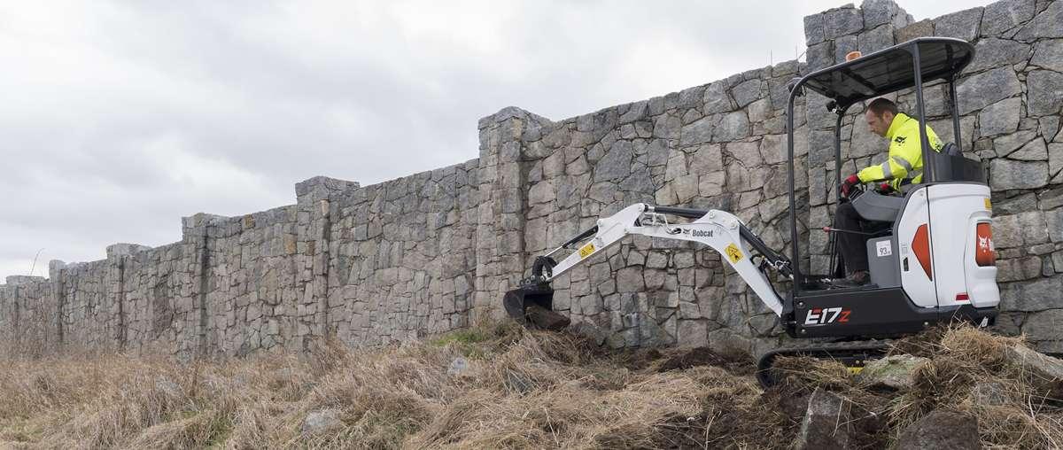 Bobcat E17z compact excavator (mini excavator) with bucket-construction attachment.