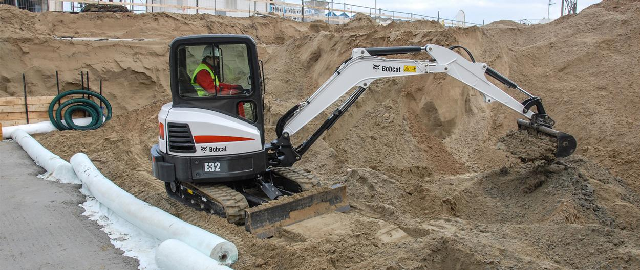 Bobcat E32 compact excavator (mini excavator) with clamp attachment.