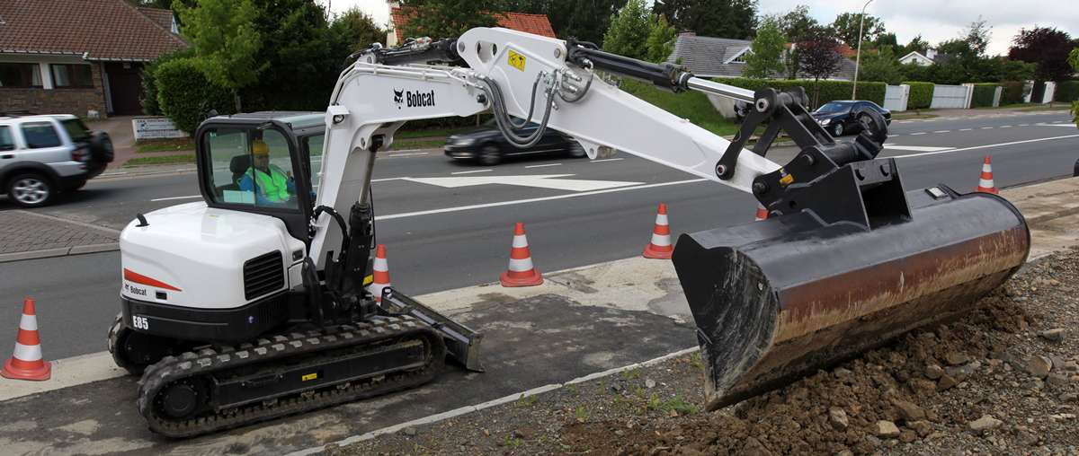 Bobcat compact (mini) Excavator E85 with Grading Bucket on road construction site