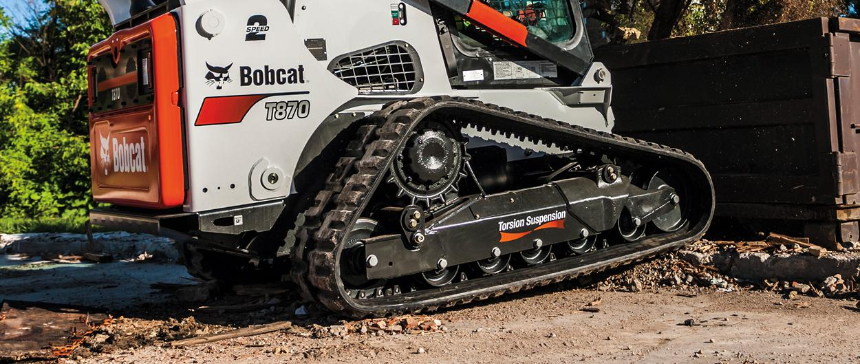 Bobcat T870 compact track loader and 5-Link torsion suspension undercarriage closeup.