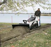 Bobcat mini track loader with pallet fork attachment.