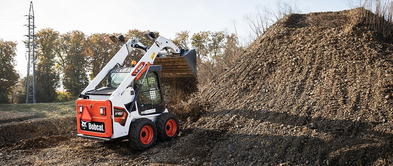 Bobcat S550-iT4-iT4 skid-steer loader with seeder attachment.