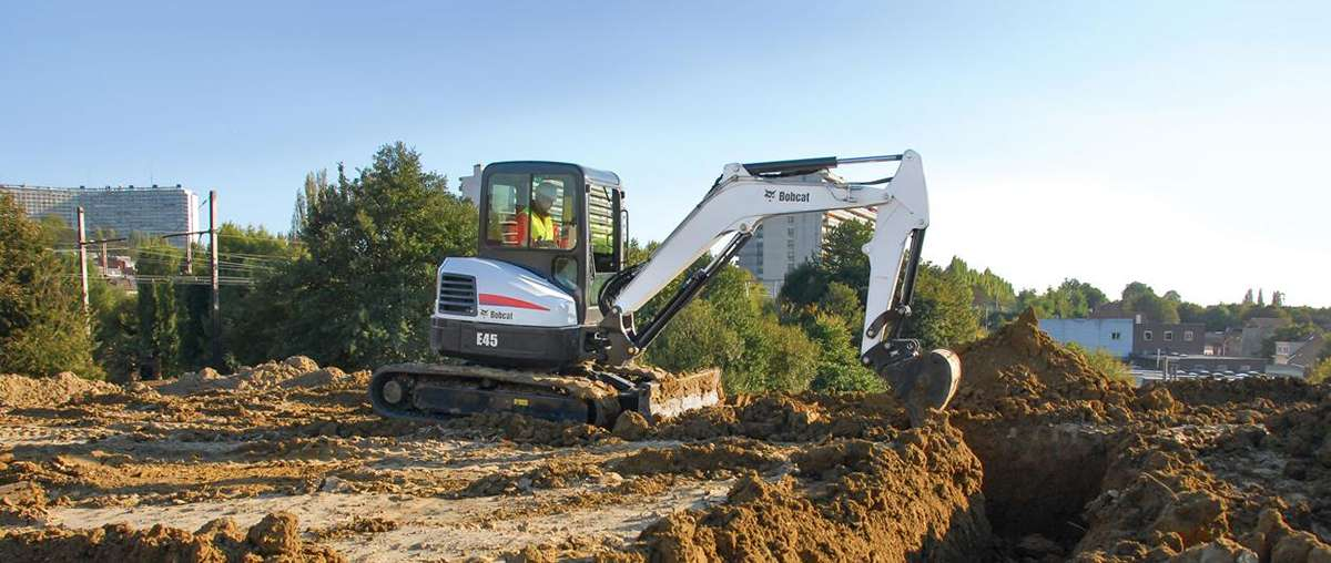 Bobcat E45 compact excavator (mini excavator) with clamp attachment.