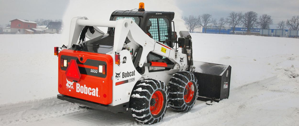 Bobcat S650 skid-steer loader with snow blower attachment.