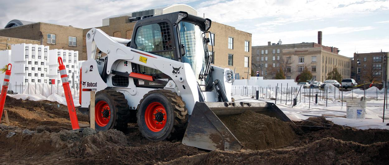 Bobcat S770 skid-steer loader with bucket.
