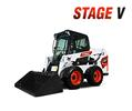 Bobcat S510 skid-steer loader dumps dirt.