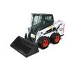 Bobcat S550 skid-steer loader clears street with snow pusher.