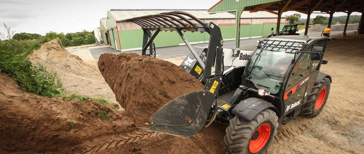 Bobcat Telescopic Loader TL38.70HF with Grapple Bucket removing dirt