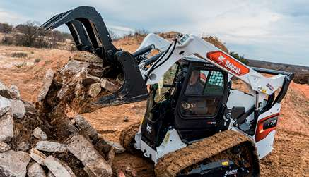 Operator Using Bobcat T76 Compact Track Loader With Grapple Attachment Purchased With Attachment Offer