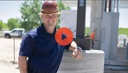 Video Preview Showing Owner Of The Caisson Company Posing In Front Of Light Pole Caisson