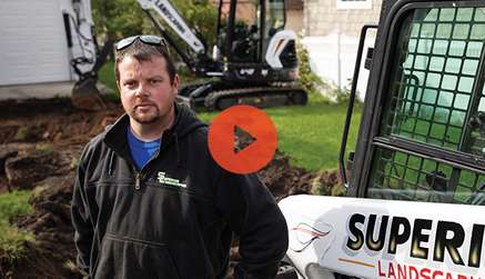 Video Preview Showing Superior Landscaping Owner Posing In Front Of His Bobcat Compact Loader and Mini Excavator