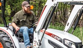 A Male Operator Using a Bobcat Compact Tractor's Front-End Loader