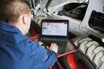 Bobcat service technician performs diagnostics on a machine.