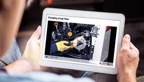 Bobcat Customer Viewing Equipment Service Videos On Tablet Device