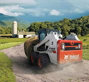 Bobcat S630 skid-steer loader with 2-speed travel option on farm.