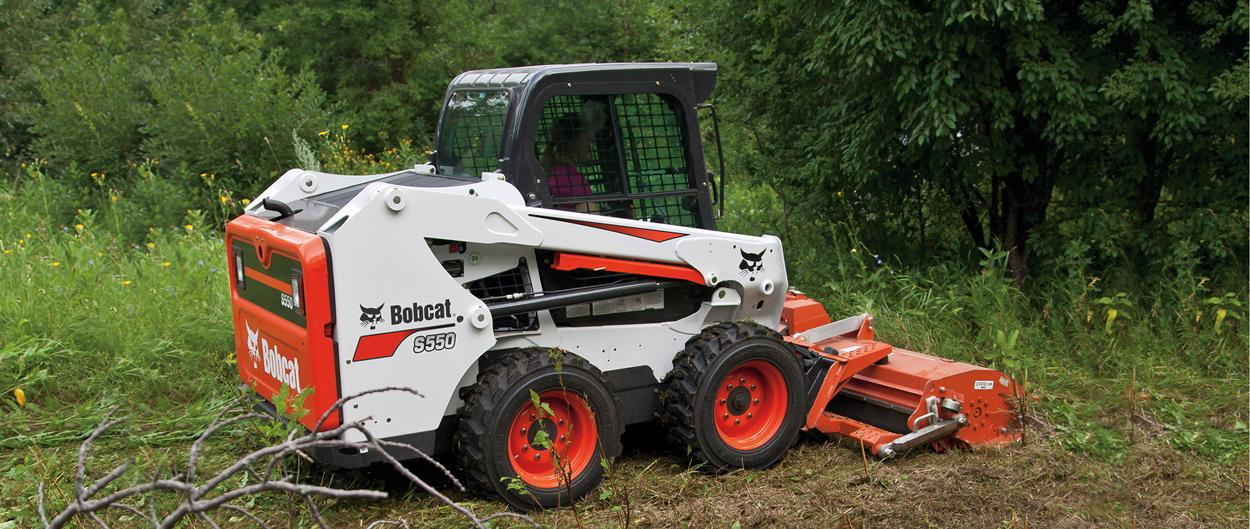 Bobcat S550 skid-steer loader with seeder attachment