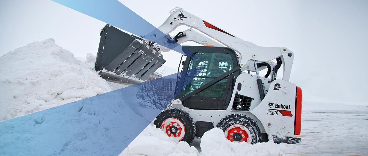 Bobcat S570 skid-steer loader and bucket attachment moving snow with graphic showing the operator's range of sight.