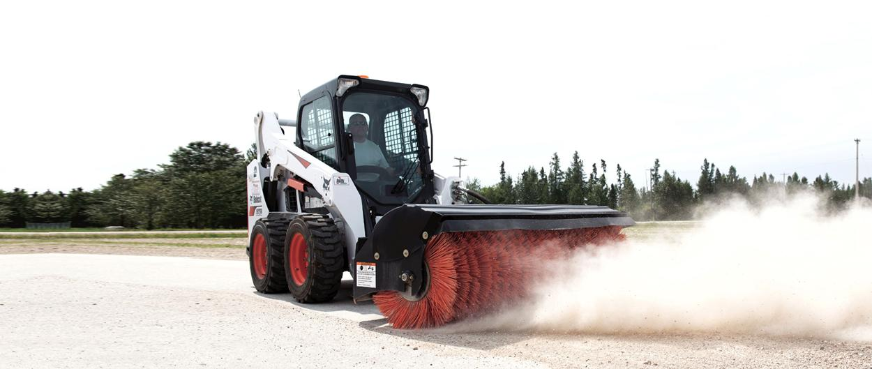 Bobcat S570 skid-steer loader and angle broom attachment.