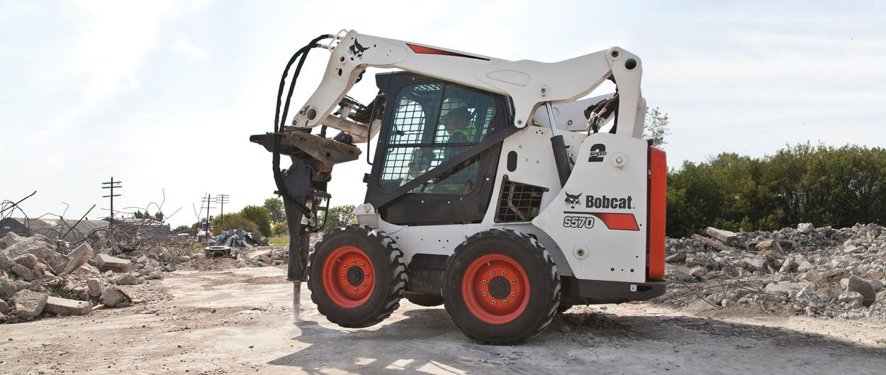 Bobcat S570 skid-steer loader and hydraulic breaker attachment.