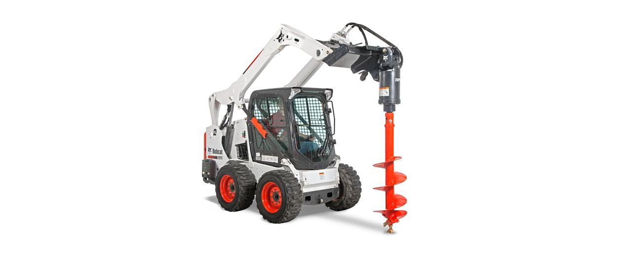 Bobcat S595 skid-steer loader with auger attachment.