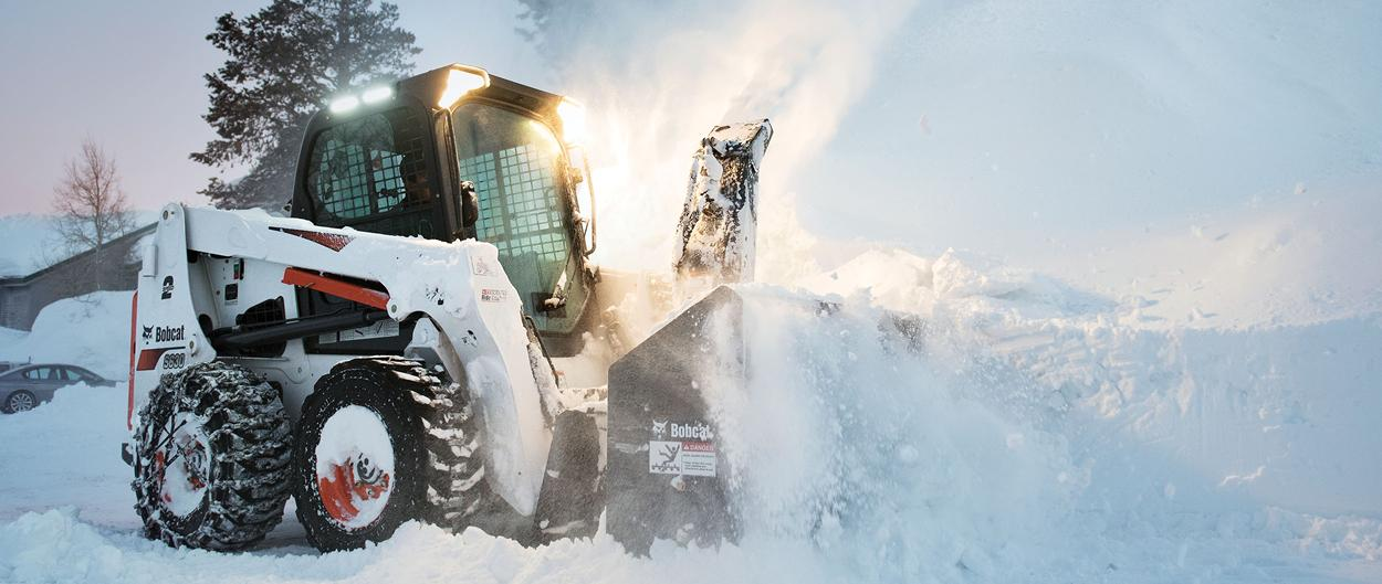 Bobcat S630 skid-steer loader with snowblower attachment.