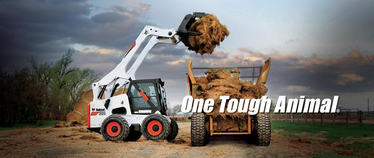 Bobcat S850 Skid-Steer Loader loading hay onto tractor