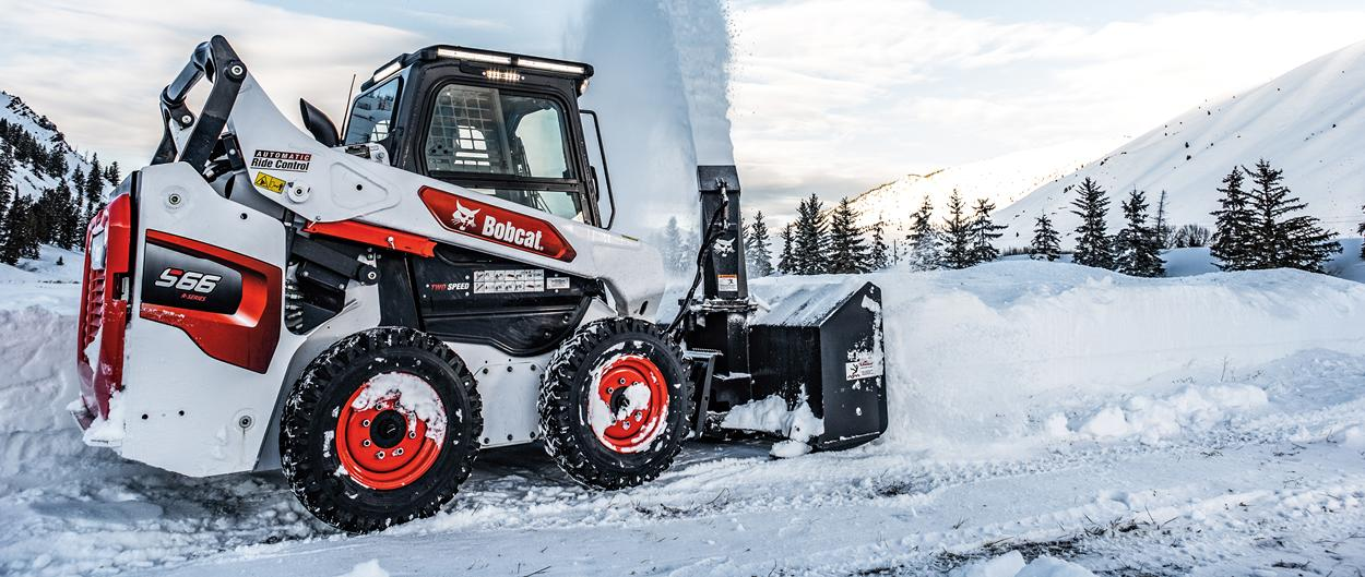 Operator Clearing Snow From Path With Bobcat S66 Snowblower