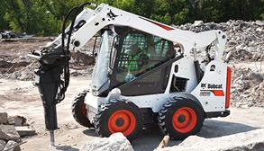 Bobcat S570 skid-steer loader and breaker attachment.