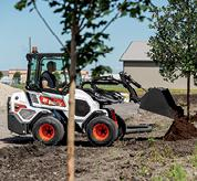 Bobcat Small Articulated Loader Planting Trees On Jobsite