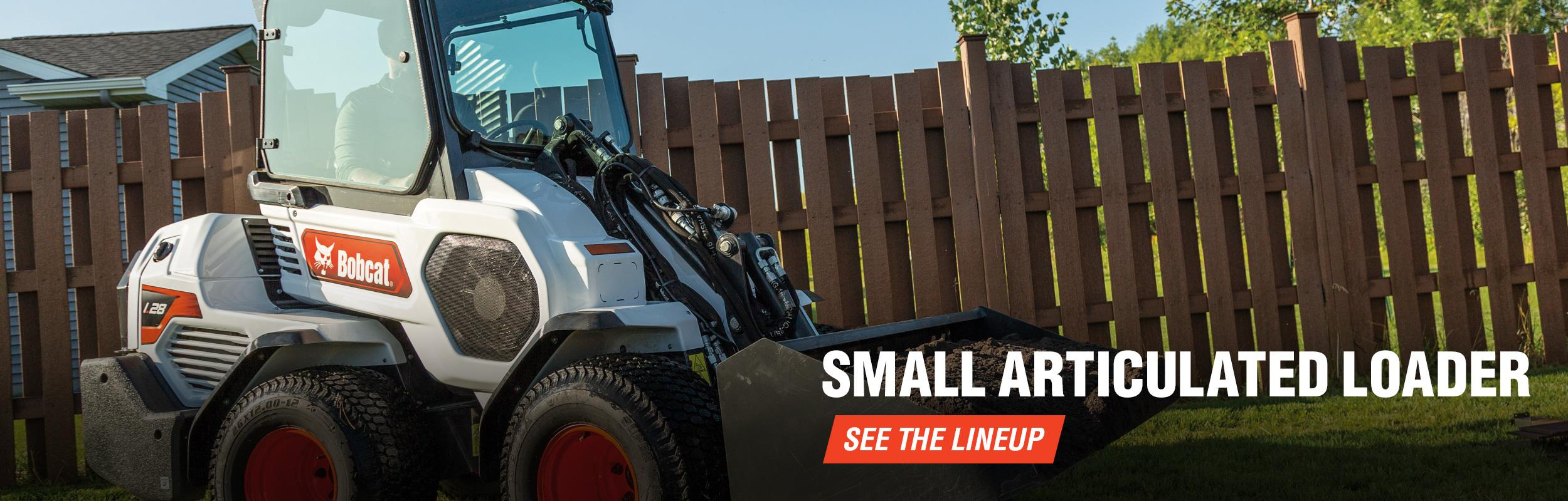 Bobcat Small Articulated Loader Parked In Yard.