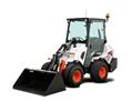 Landscaping Professional Operating A Bobcat L28 Small Articulated Loader To Move Sod With Pallet Fork Attachment