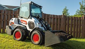 Operator Using Small Articulated Loader To Move Landscaping Material With Bucket Attachment