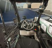 The panoramic visibility inside the VersaHANDLER V519 telehandler.