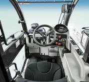 The panoramic visibility inside the VersaHANDLER V723 telehandler.