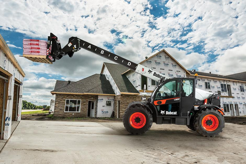 V923 Telehandler Lifts Materials High Onto Roof In Residential Construction Area