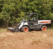 Toolcat 5600 with tiller attachment.