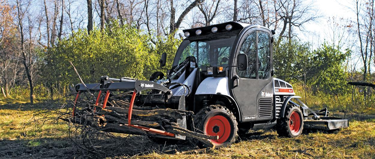 Operator Moving Brush With Toolcat Utility Work Machine