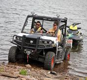 Bobcat 3600 utility vehicle pulling a trailered jet ski out of a lake.
