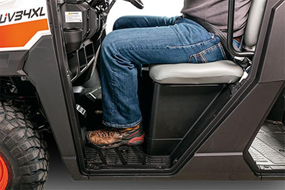 Operator Seated In The Contoured Comfort Seat Inside Bobcat Utility Vehicle Cab
