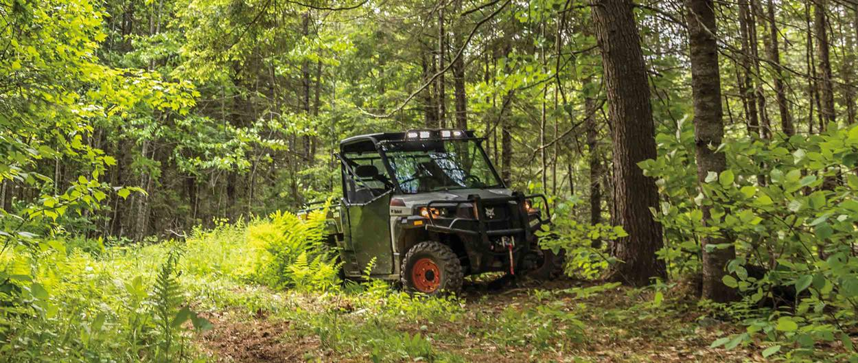 Bobcat 3400 UTV parked on a forest trail.