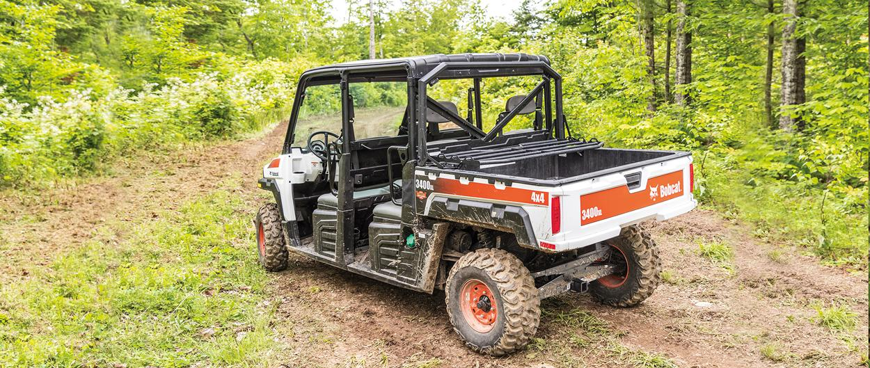 Bobcat 3400XL UTV parked on a muddy trail.