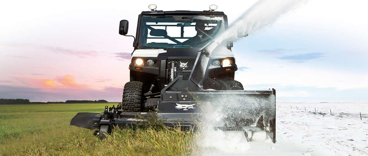 A split screen shows a Bobcat 3650 utility vehicle in the summer mowing grass and blowing snow in the winter.