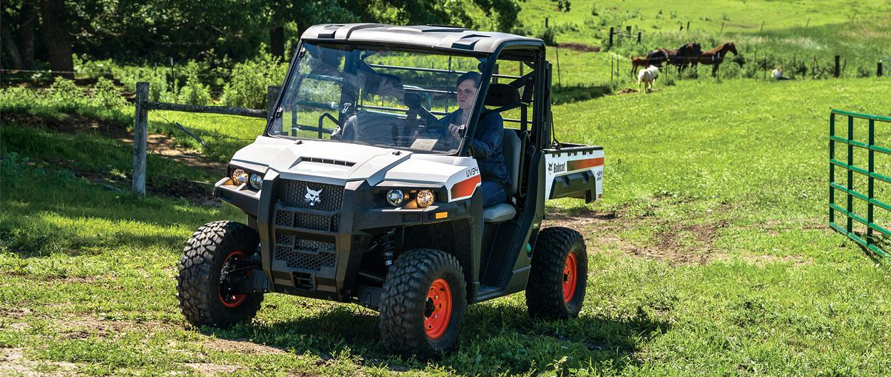 Acreage Owner Drives UV34 UTV Through Horse Pasture