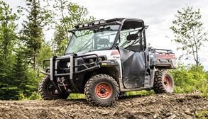 Bobcat 3400 utility vehicle (UTV) in a forest.