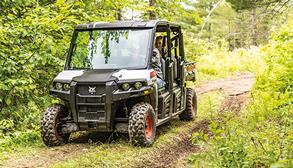 Owner Drives Bobcat UTV On Acreage