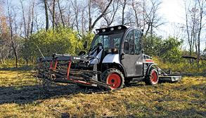 Toolcat Utility Work Machine Carrying Yard Debris With A Utility Fork