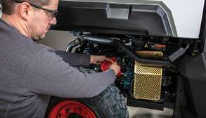 Service Technician Checks The Oil Of a Bobcat UTV