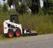Bobcat Skid Steer Loader with Brushcat attachment